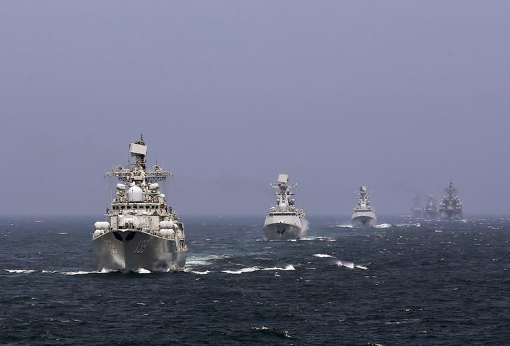 Chinese and Russian naval vessels participate in the Joint Sea-2014 naval drill outside Shanghai on the East China Sea, in this file photo taken on May 24, 2014. REUTERS/China Daily