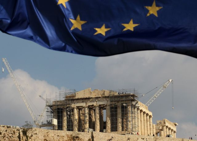 epa05853859 (FILE) - A file picture dated 03 November 2011 shows a European Union (EU) flag fluttering before the Parthenon of the Acropolis in Athens, Greece. The eurozone debt crisis, which started in 2009 when countries realised that Greece could default on its debts after Wall Street imploded in 2008, divided the EU's Eurogroup member countries over what measures to take to tackle what the OECD called the world's greatest threat in 2011. The 60th anniversary of the signing of the Treaty of Rome is marked on 25 March 2017. The treaty was signed on 25 March 1957 by Belgium, France, Italy, Luxembourg, the Netherlands and West Germany to form the European Economic Community (ECC). It continues to be one of the most important ones in the history of the European Union (EU).  EPA/ORESTIS PANAGIOTOU *** Local Caption *** 50183401